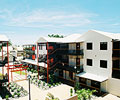 LYSAGHT CUSTOM ORB® profile in the COLORBOND® steel colour Surfmist® was used to clad the walls and roof of this development in the Chinatown precinct of Broome, Western Australia.