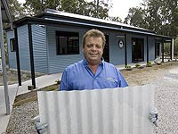STEEL BY™ Brand Partnership Program members, Queensland Shed Markets' John Umstad builds kit homes made from COLORBOND® steel and ZINCALUME® steel.