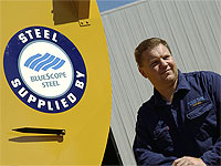 Daniel Parker of Parker Silos and Sheetmetal with his Wildcat Chaser Bins