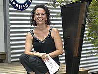 Kelly McDonald, of Queensland company Frontyard Art, with one of her companys ZINCALUME? steel letterboxes in the SPIKE range.