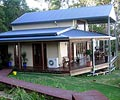 LYSAGHT® Cee Purlins and LYSAGHT CUSTOM ORB® roof cladding are part of the engineered Ranbuild solution which provided a cost effective home in the Gold Coast hinterland for a young couple.
