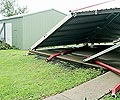 While the shed in front collapsed under Cyclone Larry's pressure, the Garage World built shed behind survived intact.