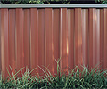 Fencing made from COLORBOND® steel in colour Red Oak®
