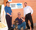 Sam from Animal Welfare League, Steve from Lakeside Roofing and David of BlueScope Lysaght at the Animal Welfare League animal shelter in Elizabeth, South Australia for which BlueScope Lysaght provided the roofing material.