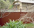 COLORBOND® steel fence in colour Red Oak®