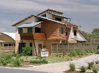 A home at Casuarina Beach featuring steel roofing made from COLORBOND® steel