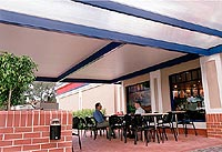 Several fast food stores in Sydney are erecting erecting awnings made from APS Versiclad, which combine an exterior of profiled COLORBOND® steel in colour Dune®, with a polystyrene insulation core and a clean, white, stucco embossed steel ceiling face