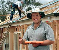 David Treloar of Bendigo-based Gary Clark Plumbing with GRAB STICK®, a magnetic tool to clamp insulating paper to steel battens even when the wind reaches levels that would normally put a stop to roofing work.